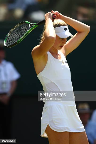 Naomi Broady of Great Britain reacts against Garbine Muguruza of Spain during their Ladies' Singles first round match on day two of the Wimbledon...