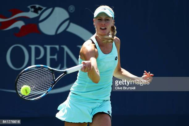 Naomi Broady of Great Britain returns a shot against Mona Barthel and Carina Witthoeft of Germany during their first round Women's Doubles match on...