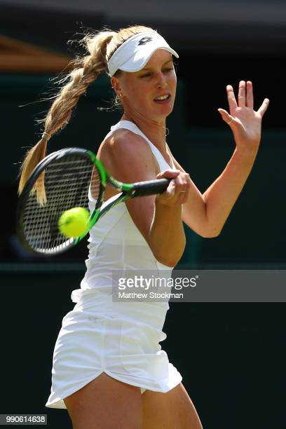 Naomi Broady of Great Britain returns against Garbine Muguruza of Spain during their Ladies' Singles first round match on day two of the Wimbledon...