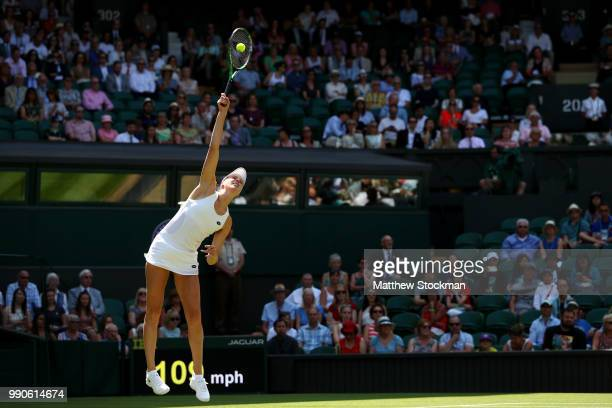 Naomi Broady of Great Britain serves against Garbine Muguruza of Spain during their Ladies' Singles first round match on day two of the Wimbledon...