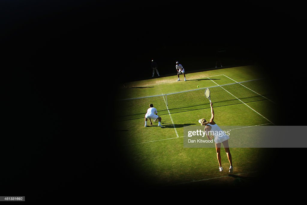 Naomi Broady of Great Britain serves during her Mixed Doubles first round match with Neal Skupski against Robert Farah of Colombia and Darija Jurak of Croatia on day five of the Wimbledon Lawn Tennis Championships at the All England Lawn Tennis and Croquet Club on June 27, 2014 in London, England.