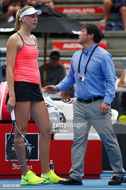 Naomi Broady of Great Britain speaks with WTA Supervisor Tony Cho following an incident during her singles match against Jelena Ostapenko of Latvia...