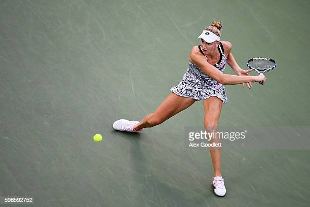 Naomi Broady of the United Kingdom returns a shot to Agnieszka Radwanska of Poland during her second round Women's Singles match on Day Four of the...