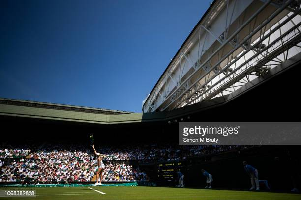 Naomi Broady of United Kingdom in action against Garbine Muguruza of Spain during the Wimbledon Lawn Tennis Championship at the All England Lawn...