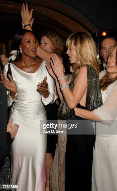 Naomi Campbell and Kate Moss attend the launch of Kate Moss's new Top Shop 'Christmas Range' collection at Annabel's October 16 2007 in London England