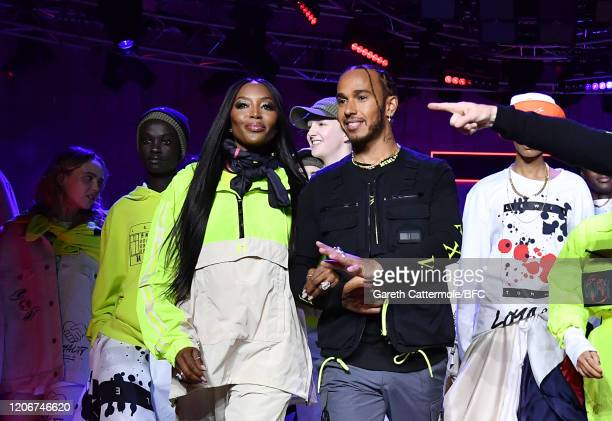 Naomi Campbell and Lewis Hamilton walk the runway with models at the TommyNow show during London Fashion Week February 2020 at the Tate Modern on...