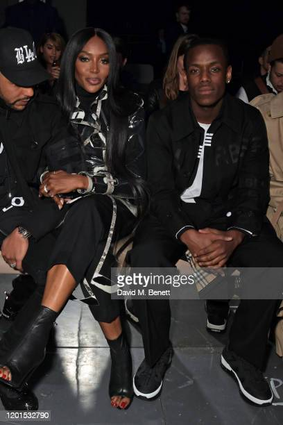 Naomi Campbell and Micheal Ward attend the Burberry Autumn/Winter 2020 show during London Fashion Week at Kensington Olympia on February 17 2020 in...