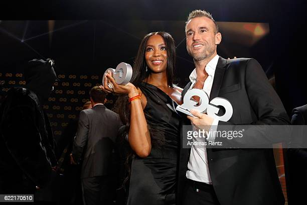 Naomi Campbell and Philipp Plein pose on stage after the GQ Men of the year Award 2016 show at Komische Oper on November 10 2016 in Berlin Germany