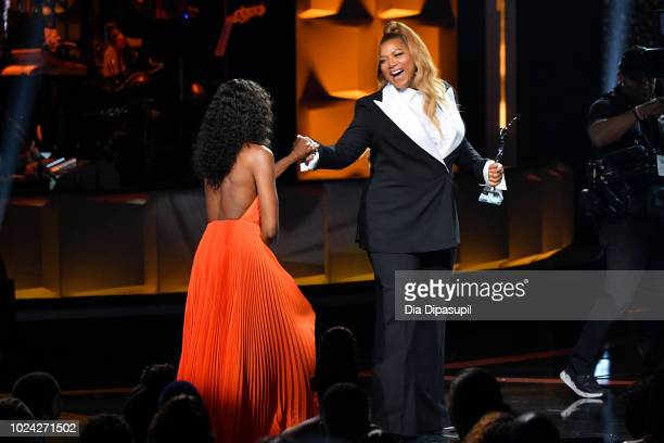 Naomi Campbell and Queen Latifah embrace onstage during the Black Girls Rock 2018 Show at NJPAC on August 26 2018 in Newark New Jersey