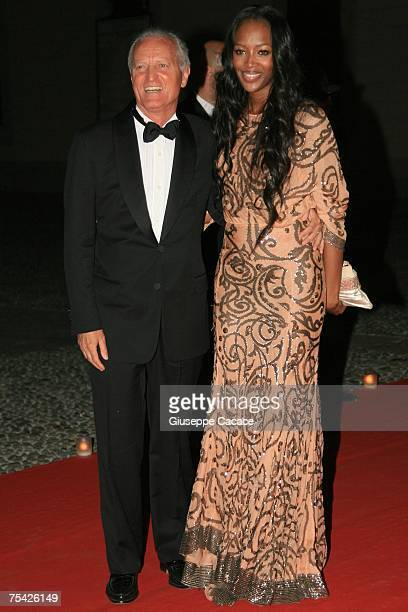 Naomi Campbell and Santo Versace arrive at the dinner at Palazzo Reale after the ballet 'Thanks Gianni with Love' to commemorate the tenth...