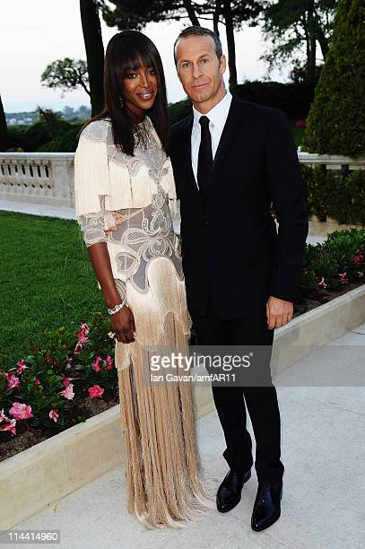 Naomi Campbell and Vladimir Doronin attend amfAR's Cinema Against AIDS Gala during the 64th Annual Cannes Film Festival at Hotel Du Cap on May 19,...