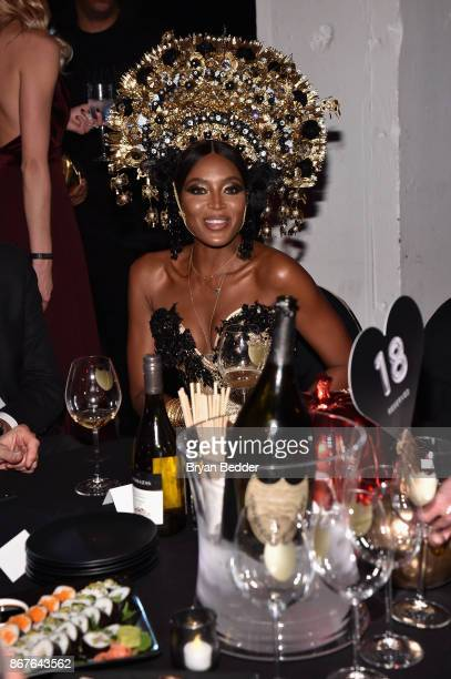 Naomi Campbell attends Moet Hennessy at The 2017 amfAR and The Naked Heart Foundation Fabulous Fund Fair on October 28 2017 in New York City