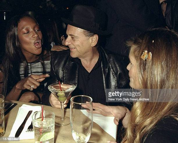 Naomi Campbell chats with her date Joe Pesci and model Elle McPherson at party at the Bowery Bar Campbell hosted bash to promote the opening of...