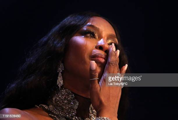 Naomi Campbell cries as she accepts the Icon Award on stage during The Fashion Awards 2019 held at Royal Albert Hall on December 02, 2019 in London,...