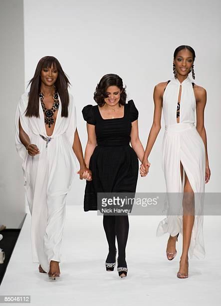 Naomi Campbell designer Daniella Issa Helayel and a model walk the runway at the ISSA fashion show during London Fashion Week Spring/Summer 2009 at...