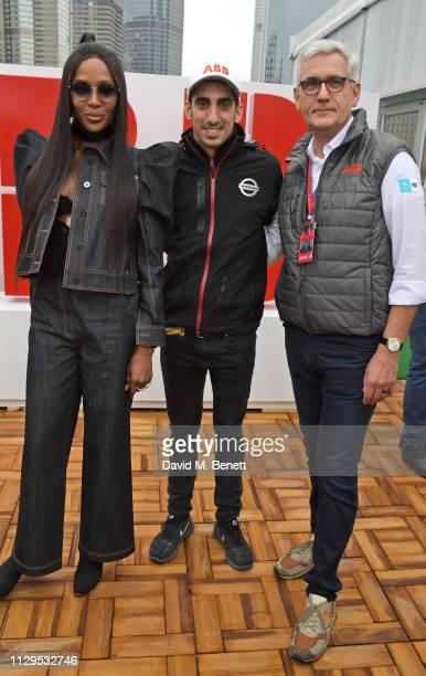 Naomi Campbell FIA Formula E racing driver Sebastien Buemi and CEO of ABB Ltd Dr Ulrich Spiesshofer attend the ABB FIA Formula E HKT Hong Kong EPrix...