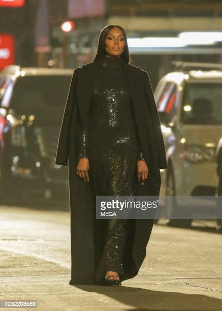 Naomi Campbell is seen walking in the Michael Kors fashion show in Times Square on April 8, 2021 in New York City.