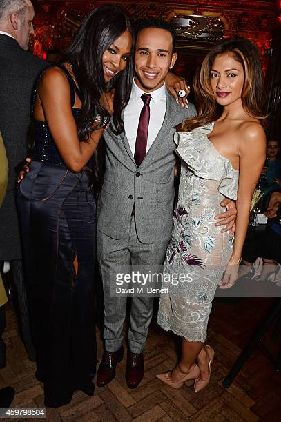 Naomi Campbell Lewis Hamilton and Nicole Scherzinger attend a party in celebration of Edward Enninful in The Oscar Wilde Bar Hotel Cafe Royal on...