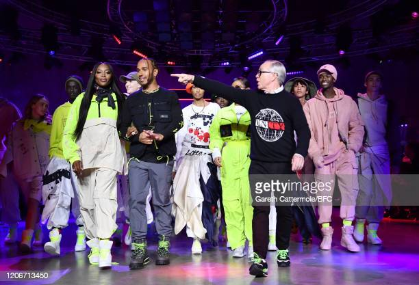 Naomi Campbell Lewis Hamilton and Tommy Hilfiger walk the runway with models at the TommyNow show during London Fashion Week February 2020 at the...
