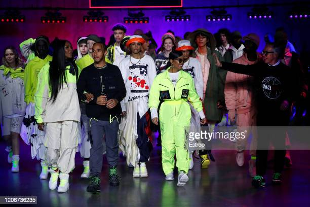Naomi Campbell & Lewis Hamilton walking at the TommyNow show during London Fashion Week February 2020 at the Tate Modern on February 16, 2020 in...