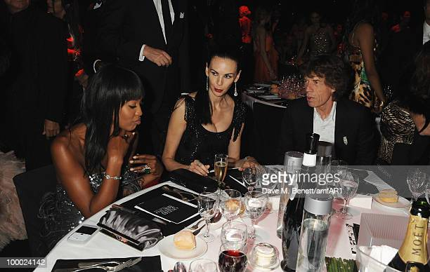 Naomi Campbell L'Wren Scott and Mick Jagger attend amfAR's Cinema Against AIDS 2010 benefit gala dinner at the Hotel du Cap on May 20 2010 in Antibes...