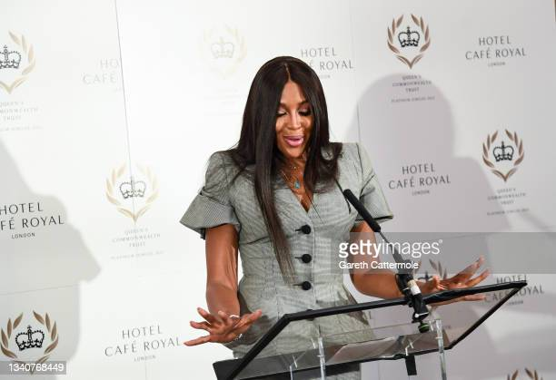 Naomi Campbell makes a speech at the Queen's Commonwealth Trust press conference at Hotel Cafe Royal on September 16, 2021 in London, England. Naomi...