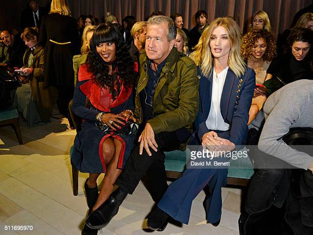 Naomi Campbell Mario Testino and Rosie HuntingtonWhiteley wearing Burberry at the Burberry Womenswear February 2016 Show at Kensington Gardens on...
