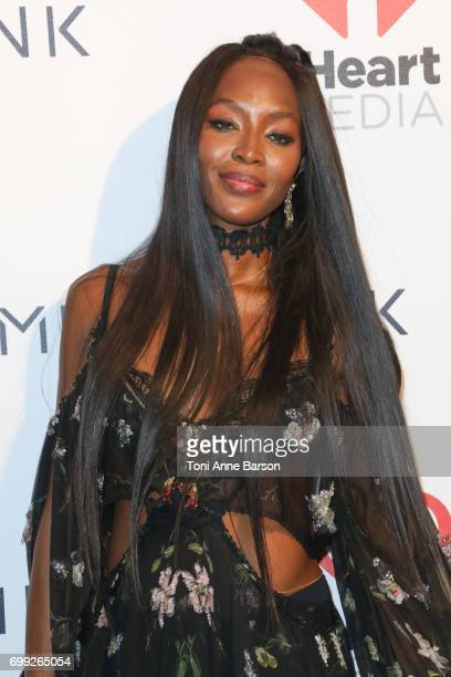 Naomi Campbell poses after The Weeknd performance at a VIP dinner party hosted by iHeartMedia and MediaLink at Hotel du CapEdenRock in Antibes France...