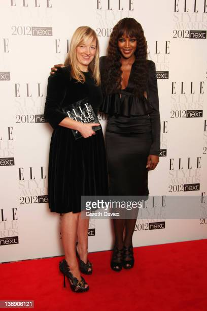 Naomi Campbell poses with Sarah Burton after presenting her with the International Designer of the year Award in the press room at The ELLE Style...