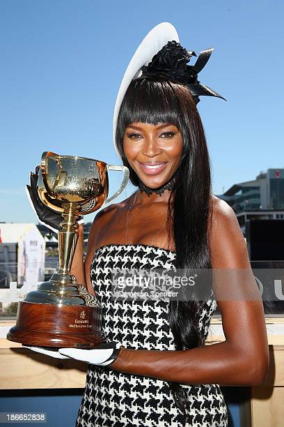 Naomi Campbell poses with the Melbourne Cup at the Lexus marquee on Victoria Derby Day at Flemington Racecourse on November 2 2013 in Melbourne...