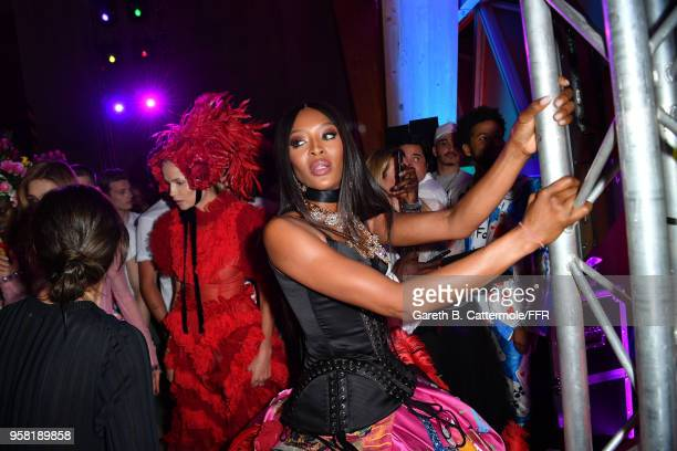 Naomi Campbell prepares backstage at Fashion for Relief Cannes 2018 during the 71st annual Cannes Film Festival at Aeroport Cannes Mandelieu on May...
