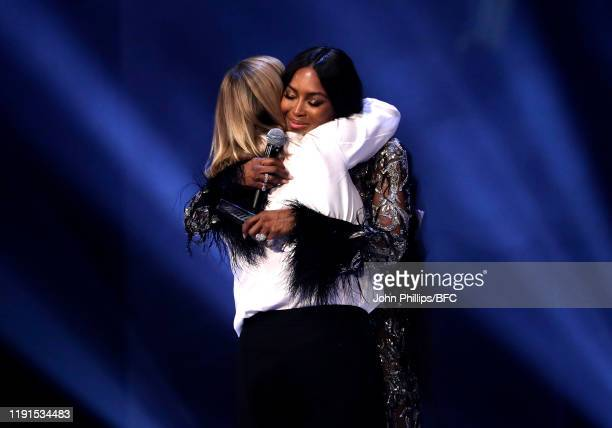 Naomi Campbell presents the Trailblazer Award to Sarah Burton for Alexander McQueen on stage during The Fashion Awards 2019 held at Royal Albert Hall...