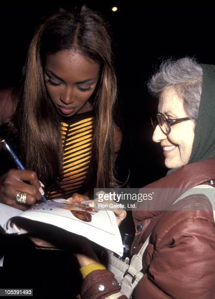 Naomi Campbell signs an autograph for a fan during Haimoff - Grubman Wedding Reception - October 12, 1991 at New York Public Library in New York...