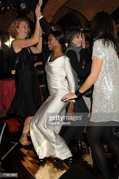 Naomi Campbell singer Chrissie Hynde and Trish Simonen attend the launch of Kate Moss's new Top Shop 'Christmas Range' collection at Annabel's...