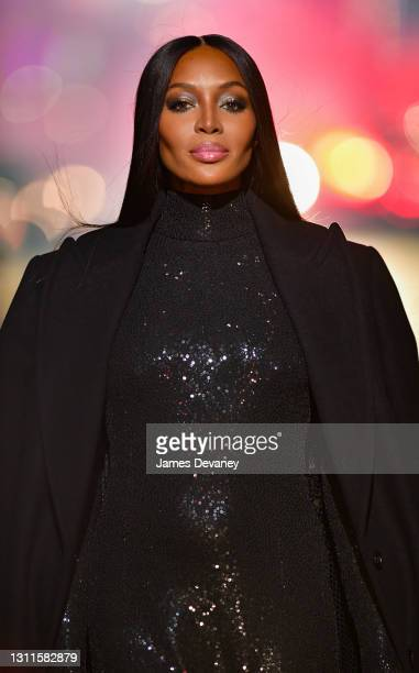 Naomi Campbell walks along 46th Street during the Michael Kors Fashion Show in Times Square on April 08, 2021 in New York City.