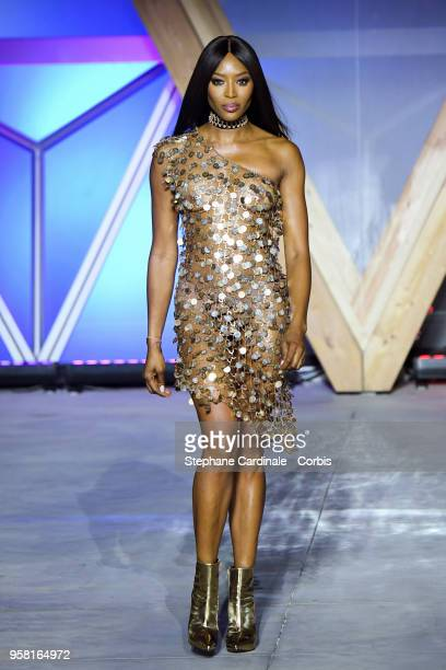 Naomi Campbell walks the runway at Fashion For Relief Cannes 2018 during the 71st annual Cannes Film Festival at Aeroport Cannes Mandelieu on May 13...