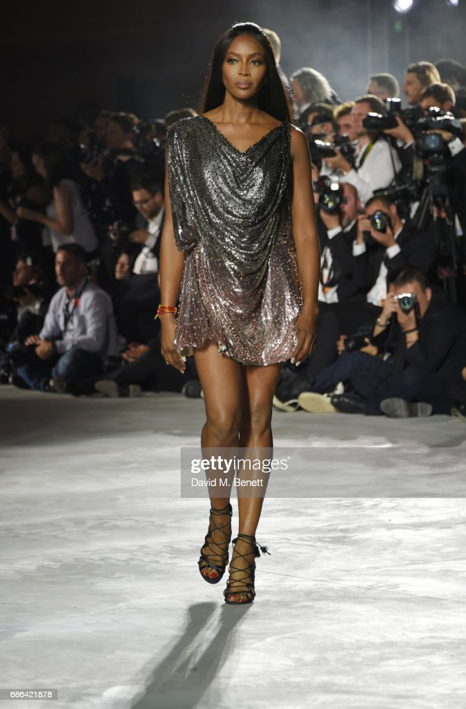 Naomi Campbell walks the runway at the Fashion for Relief event during the 70th annual Cannes Film Festival at Aeroport Cannes Mandelieu on May 21, 2017 in Cannes, France.