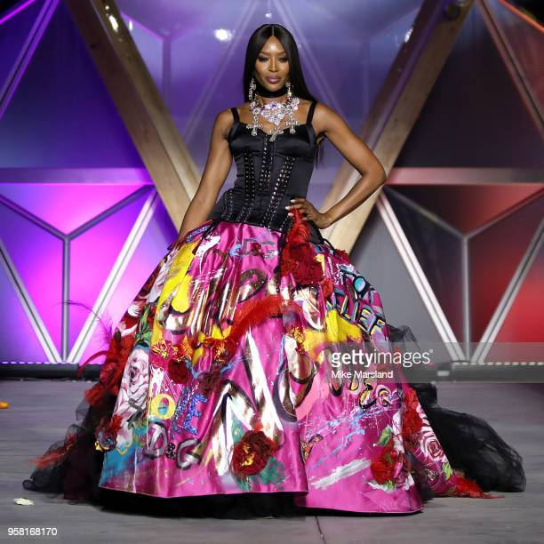 Naomi Campbell walks the runway during Fashion For Relief Cannes 2018 during the 71st annual Cannes Film Festival at Aeroport Cannes Mandelieu on May...