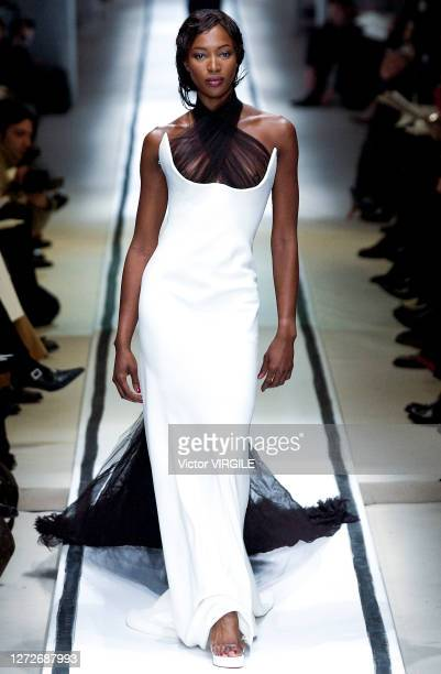 Naomi Campbell walks the runway during the Jean Paul Gaultier Haute Couture Spring/Summer 2002 fashion show in his new address before...