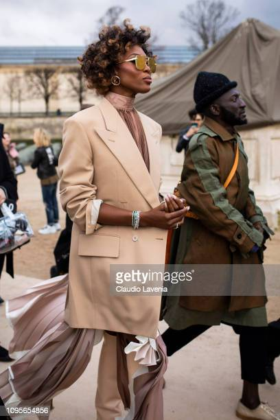 Naomi Campbell wearing a beige blazer beige dress beige boots and Louis Vuitton bag is seen in the streets of Paris after the Louis Vuitton show on...