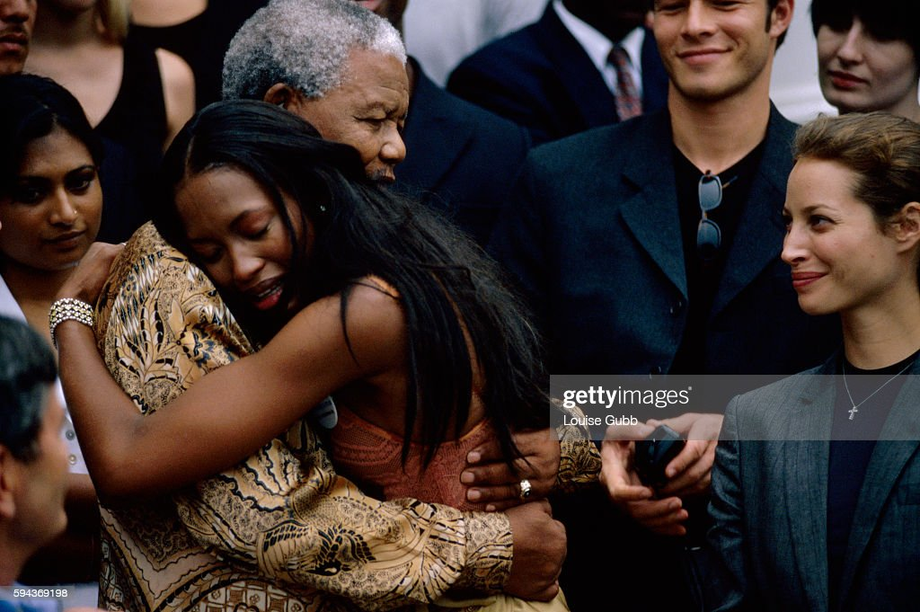 Naomi Campbell weeps with emotion as she embraces her hero Nelson Mandela. Former President of South Africa and longtime political prisoner, Nelson Mandela, was held by the apartheid based government from 1964-1990 for sabotage. With the coming of a freer political climate, Nelson Mandela was released from his life sentence at Victor Vester Prison on February 11, of 1990. He went on to lead the African National Congress in negotiations with President F. W. de Klerk, that resulted in the end of apartheid and full citizenship for all South Africans. He and de Klerk received a joint Nobel Prize in 1993 for their efforts. Mandela was elected president in 1994.