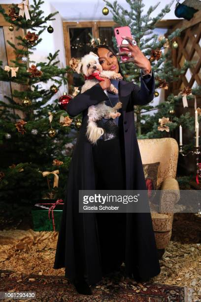 Naomi Campbell with dog takes a selfie during the Gut Aiderbichl Christmas Market opening on November 13, 2018 in Henndorf am Wallersee, Austria.