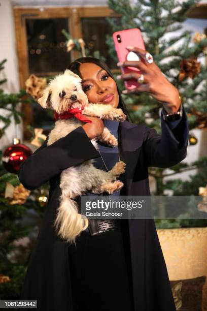 Naomi Campbell with dog takes a selfie during the Gut Aiderbichl Christmas Market opening on November 13 2018 in Henndorf am Wallersee Austria