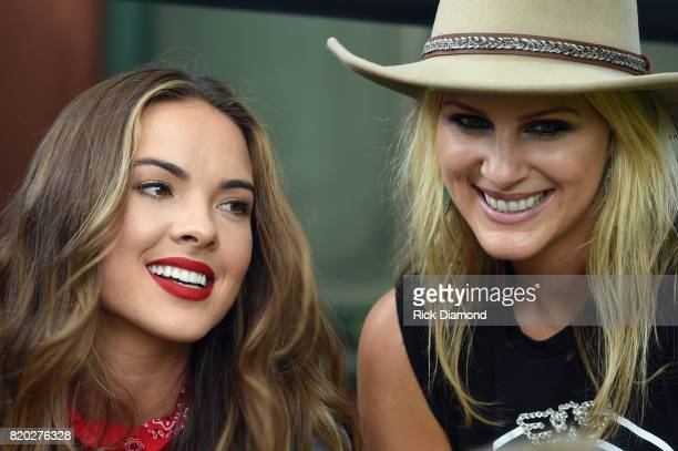 Naomi Cooke and Jennifer Wayne of Country Trio Runaway June backstage during Country Thunder In Twin Lakes Wisconsin Day 1 on July 20 2017 in Twin...