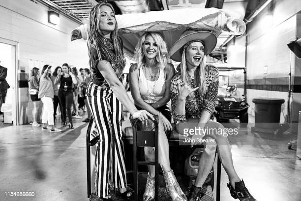 Naomi Cooke Jennifer Wayne and Hannah Mulholland of musical group Runaway June attend day 3 of the 2019 CMA Music Festival at Nissan Stadium on June...