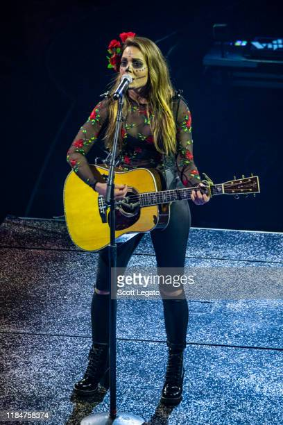 Naomi Cooke of Runaway June performs dressed up for Halloween during the Cry Pretty Tour 360 at Little Caesars Arena on October 31 2019 in Detroit...