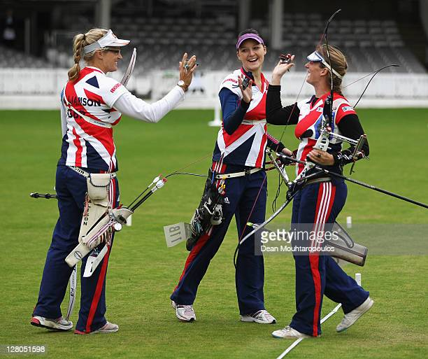 Naomi Folkard Alison Williamson and Amy Oliver celebrate winning their quarter final match in the Womens Team Event during the London Archery Classic...