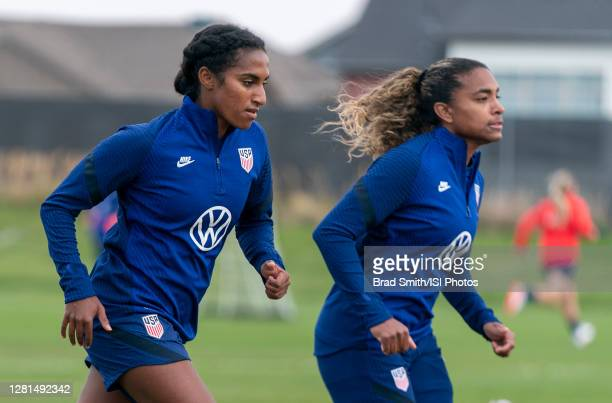 Naomi Girma and Catarina Macario of the USWNT sprint during a training session at Dick's Sporting Goods Park training fields on October 20 2020 in...