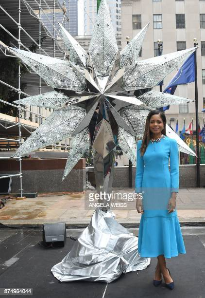 Naomi Harris poses in front of the Swarovski Star before it is raised to the top of the worldfamous Rockefeller Christmas tree on November 16 2017 in...