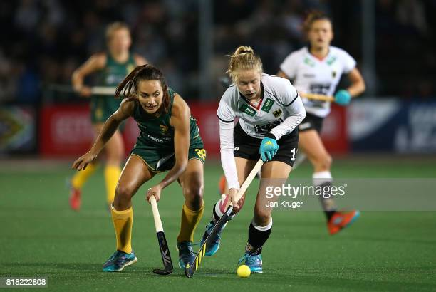 Naomi Heyn of Germany battles with Quanita Bobbs of South Africa during day 6 of the FIH Hockey World League Women's Semi Finals quarter final match...